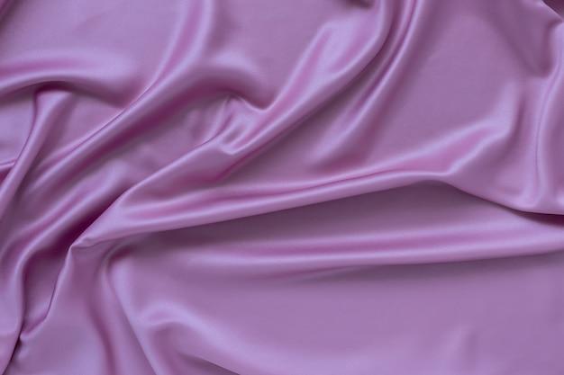 Fioletowy jedwabny materiał, miękkie fale na powierzchni. luksusowy styl tło.