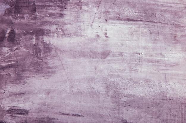 Fiołka betonowy tło, ściana z teksturą, przygotowanie dla projekta.