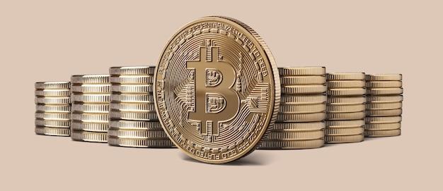 Fizyczna złota moneta bitcoin kryptowaluta i stosy bitcoinów