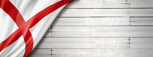 Flaga alabamy na białym banerze ściennym z drewna, usa. ilustracja 3d