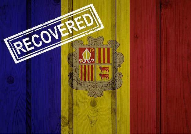 Flaga andory, która przetrwała lub wyzdrowiała z infekcji epidemii koronawirusa lub koronawirusa. flaga grunge z pieczęcią odzyskane
