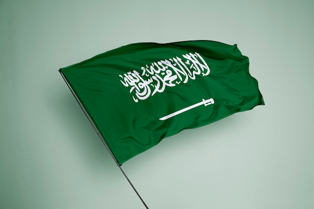 Flaga arabii saudyjskiej w tle