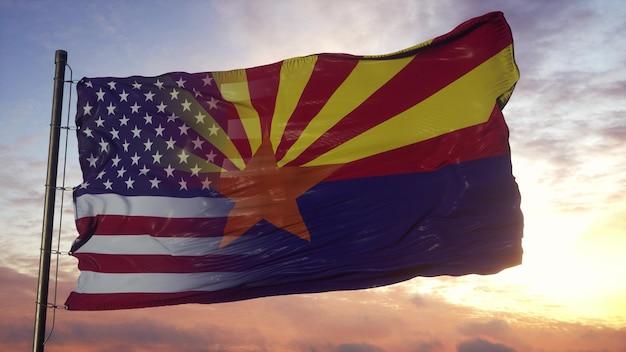 Flaga arizony i usa na masztem. stany zjednoczone i arizona mieszana flaga macha na wietrze