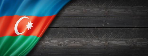 Flaga azerbejdżanu na czarnej ścianie z drewna