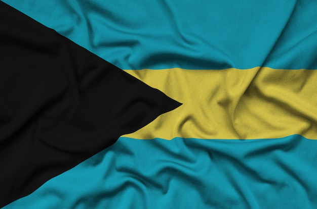 Flaga bahamów jest przedstawiona na sportowej tkaninie z wieloma zakładkami.