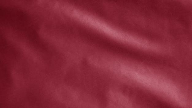 Flaga czerwona tkanina tekstylna, streszczenie tło z miękkimi falami. koncepcja znaki symbole komunizmu. ostrzeżenie o stanie wojennym