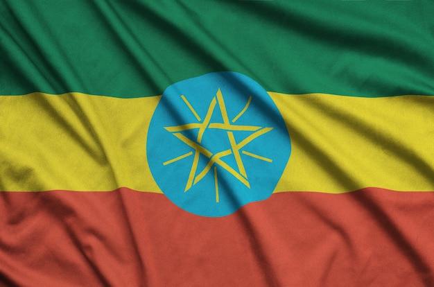 Flaga etiopii jest przedstawiona na sportowej tkaninie z wieloma zakładkami.