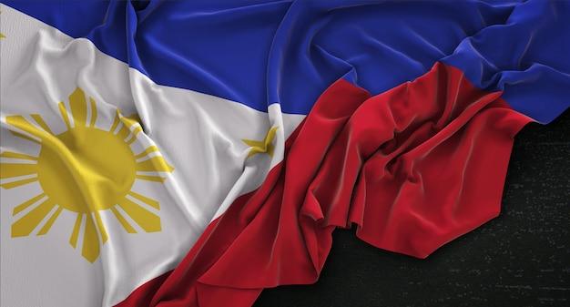 Flaga filipiny zgnieciony na ciemnym tle renderowania 3d