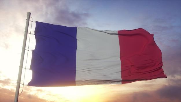 Flaga francji macha na wietrze. zbliżenie flagi republiki francuskiej. renderowanie 3d