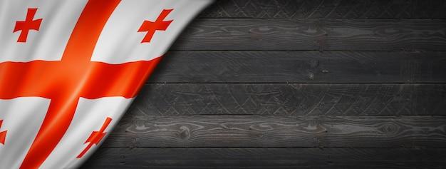 Flaga gruzji na czarnej ścianie z drewna