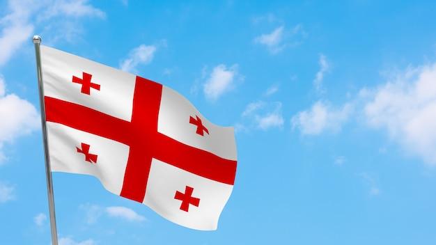 Flaga Gruzji Na Słupie. Niebieskie Niebo. Flaga Narodowa Gruzji Premium Zdjęcia
