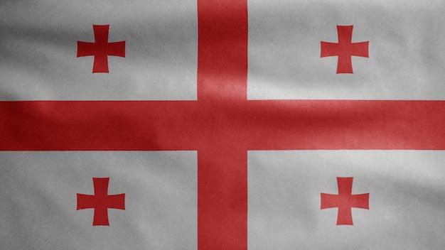 Flaga gruzji na wietrze. zbliżenie na transparent gruzji dmuchanie, miękki i gładki jedwab. tkanina tkanina tekstura tło chorąży. użyj go do koncepcji świąt narodowych i okazji krajowych.