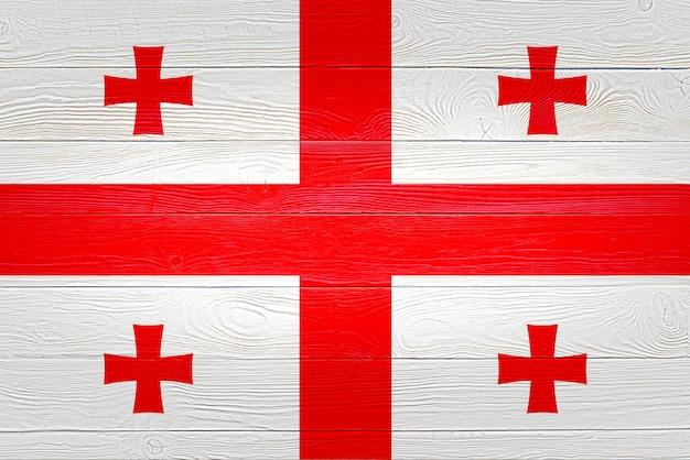 Flaga gruzji namalowana na drewnianych deskach