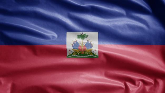 Flaga haiti na wietrze. zamknij się z haiti banner dmuchanie gładkiego jedwabiu.