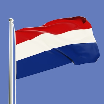 Flaga holandii na maszcie machającym na wietrze na tle błękitnego nieba