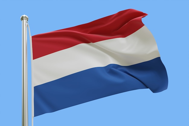 Flaga holandii na masztem macha na wietrze. pojedynczo na niebieskim niebie