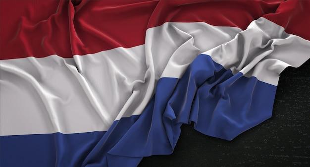 Flaga holandii zmarszczki na ciemnym tle renderowania 3d