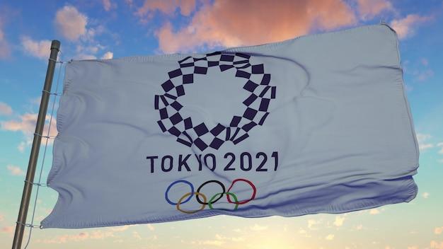 Flaga igrzysk olimpijskich w tokio 2021 powiewa na wietrze