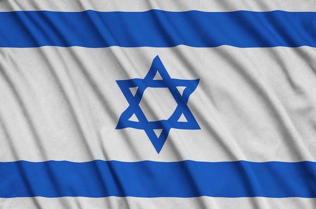 Flaga izraela jest przedstawiona na sportowej tkaninie z wieloma zakładkami.