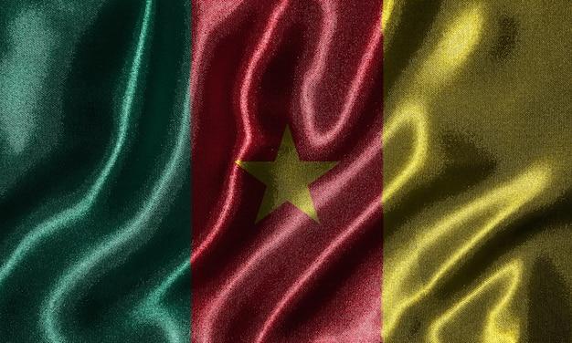 Flaga kamerunu - tkanina flaga kraju kamerun, tło macha flagą włókienniczych.