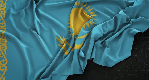 Flaga kazachstanu pomarszczony na ciemnym tle renderowania 3d