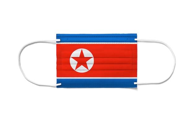 Flaga korei północnej na jednorazowej masce chirurgicznej