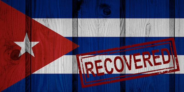 Flaga kuby, która przeżyła lub wyzdrowiała z infekcji epidemii koronawirusa lub koronawirusa. flaga grunge z pieczęcią odzyskane
