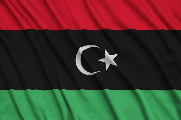 Flaga libii jest przedstawiona na sportowej tkaninie z wieloma zakładkami.