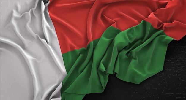 Flaga madagaskaru zmarszczki na ciemnym tle renderowania 3d