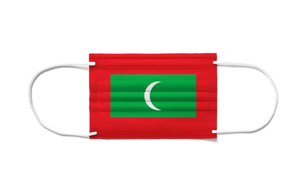 Flaga malediwów na jednorazowej masce chirurgicznej.
