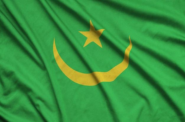Flaga mauretanii jest przedstawiona na sportowej tkaninie z wieloma zakładkami.