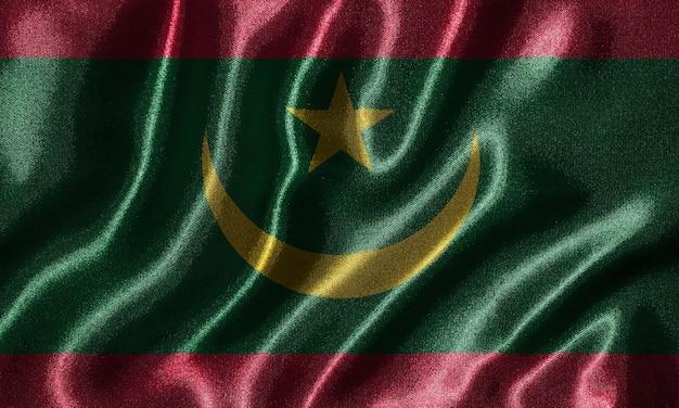 Flaga mauretanii - tkanina flaga kraju mauretanii, tło macha flagą.