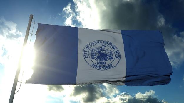 Flaga miasta grand rapids, miasta michigan, stany zjednoczone ameryki, macha na wietrze w błękitne niebo. renderowanie 3d