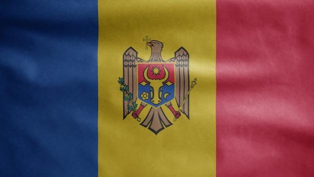 Flaga mołdawii na wietrze. baner mołdawski dmuchany gładkim jedwabiem. chorąży tekstury tkaniny