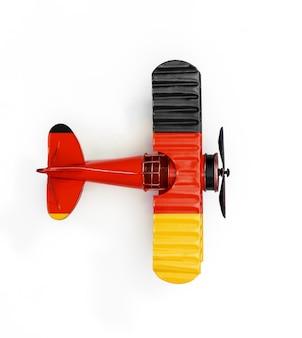 Flaga narodowa niemiec podróży metalowy samolot zabawka samodzielnie na białym tle