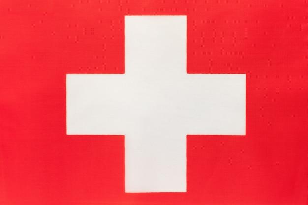 Flaga narodowa szwajcaria tkaniny, tło włókienniczych