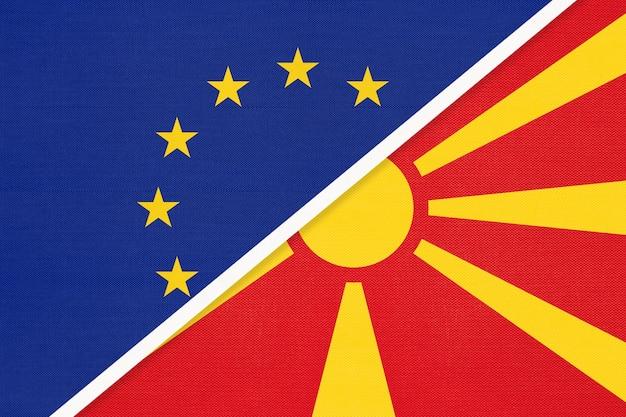 Flaga narodowa unii europejskiej lub ue vs republika macedonii północnej z tekstyliów.