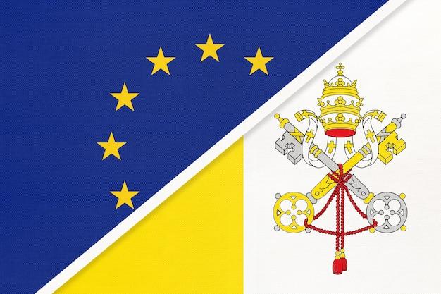 Flaga narodowa unii europejskiej lub ue vs watykan z tekstyliów.