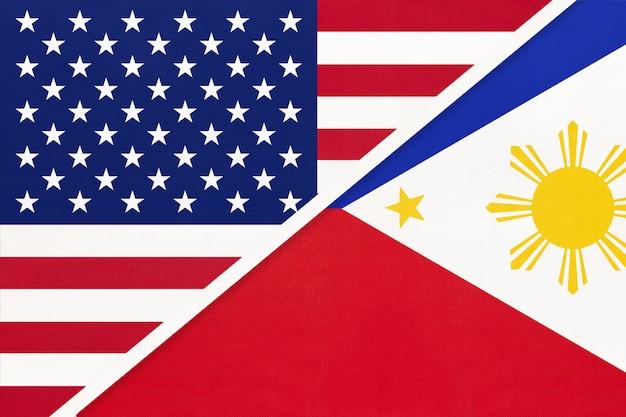 Flaga narodowa usa vs filipiny z tekstyliów. relacje między dwoma krajami amerykańskimi i azjatyckimi.