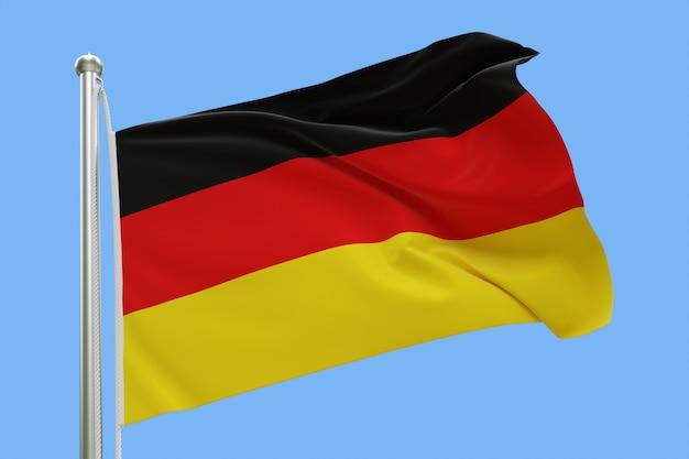 Flaga niemiec na masztem macha na wietrze. pojedynczo na niebieskim niebie