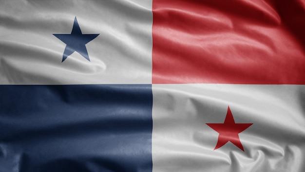 Flaga panamy na wietrze. zamknij się dmuchanie szablonu panamy, miękkiego i gładkiego jedwabiu. tkanina tekstura tło chorąży