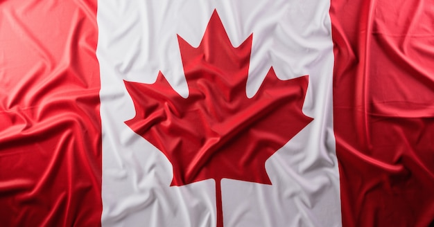 Flaga państowowa kanada z sukienną teksturą, zamyka up.