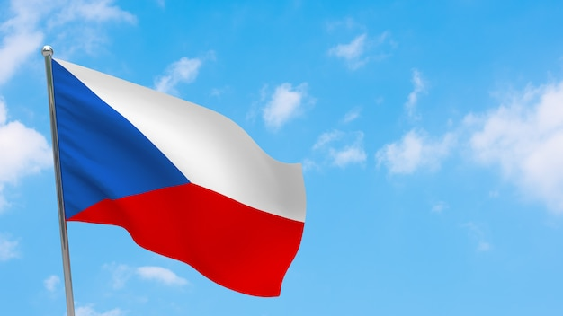 Flaga republiki czeskiej na słupie. niebieskie niebo. flaga narodowa republiki czeskiej