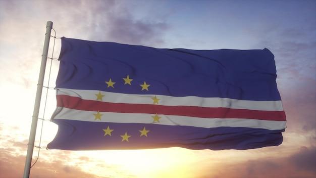 Flaga republiki zielonego przylądka macha na tle wiatru, nieba i słońca. renderowania 3d.