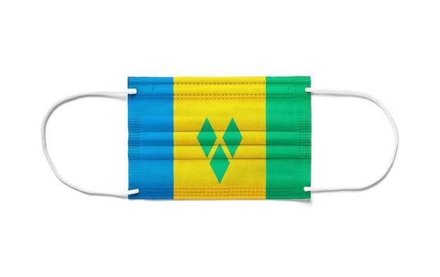 Flaga saint vincent i grenadyny na jednorazowej masce chirurgicznej.
