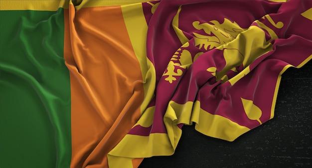 Flaga sri lanki zgnieciony na ciemnym tle renderowania 3d