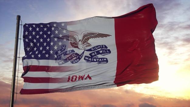 Flaga stanu iowa i usa na maszcie. flaga usa i stanu iowa na wietrze