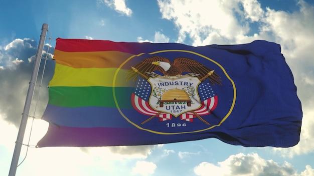 Flaga stanu utah i lgbt. mieszane flagi utah i lgbt powiewają na wietrze. renderowania 3d.