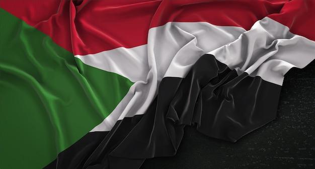 Flaga sudanu pomarszczony na ciemnym tle renderowania 3d