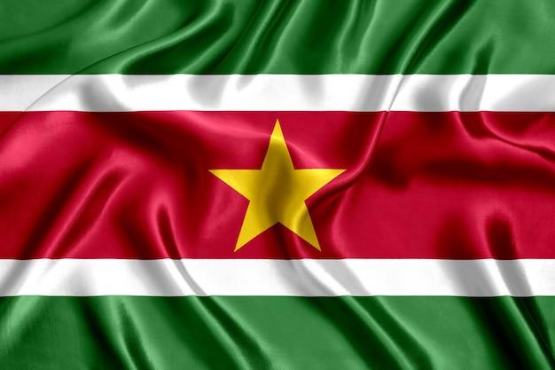 Flaga surinamu jedwabiu z bliska